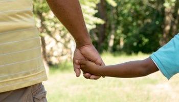 Parental abduction: holding child's hand