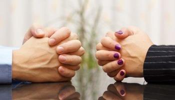 Couple hands facing divorce